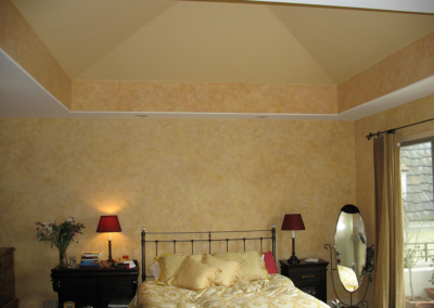Color design for walls, border, and trayed ceiling in a multi-colored decorative wash finish