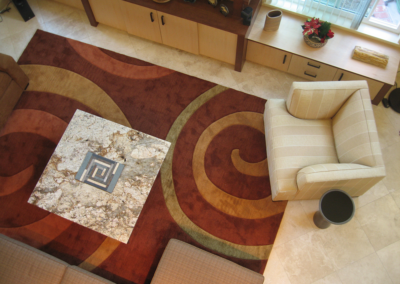 Custom coffee table with custom spiral carpet design and color