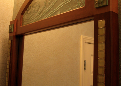 Custom bathroom mirrors with inlaid kiln formed glass, custom glaze colors and detailing