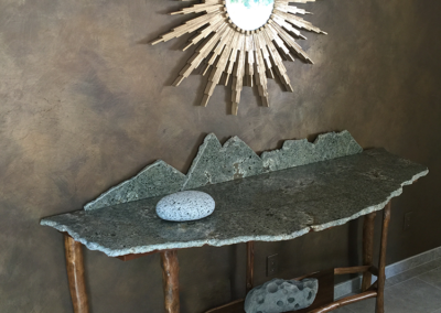 Mountain range buffet table with sunburst mirror and hand painted accent wall finish