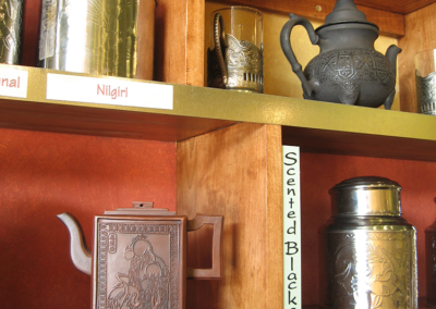 Custom shelving and magnetic display labels for Infusions Tea House