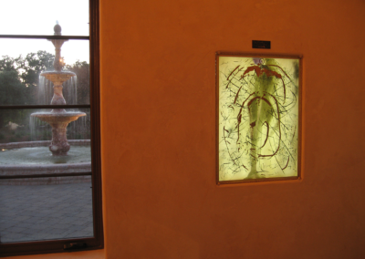 Dali exhibit - Chinese alchemy print lit from behind with courtyard fountain made of chinese marble.