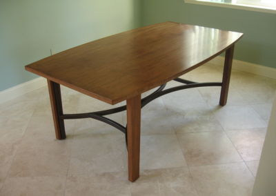 Custom dining table with welded base