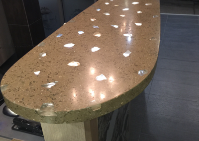 Custom hotel check -in counter made from cast concrete with inlaid glass and lit from underneath