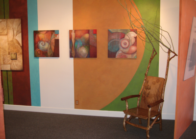 Wall murals with paintings and Antler chair