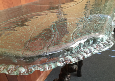 Close-up of kiln formed topographic map in glass
