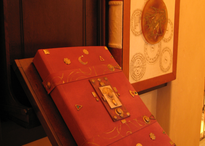 Dali exhibit - Book of six philosophies re-bound and decorated with alchemical symbols